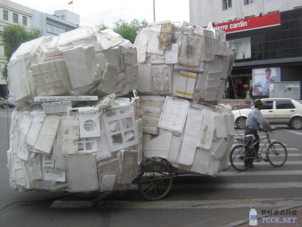 李三炳收废品创业